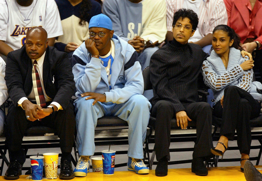 . Actor Samuel L. Jackson, Musician Prince and wife Manuela Testolini watch the Los Angeles Lakers game against the Miami Heat at the Staples Center December 25, 2004 in Los Angeles, California. (Photo by Matthew Simmons/Getty Images)