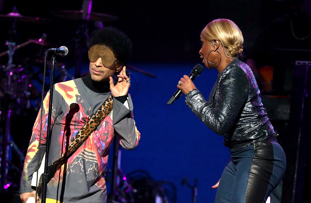 . Recording artist Prince (L) and singer Mary J. Blige perform onstage during the 2012 iHeartRadio Music Festival at the MGM Grand Garden Arena on September 22, 2012 in Las Vegas, Nevada.  (Photo by Christopher Polk/Getty Images for Clear Channel)
