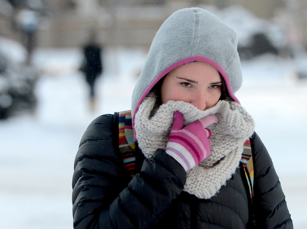 . University of Colorado students, Lauren Dody, tries to keep warm on her walk to class.  Single digit cold, both above and below zero on Wednesday morning, February 5, 2014. (Cliff Grassmick / The Daily Camera)
