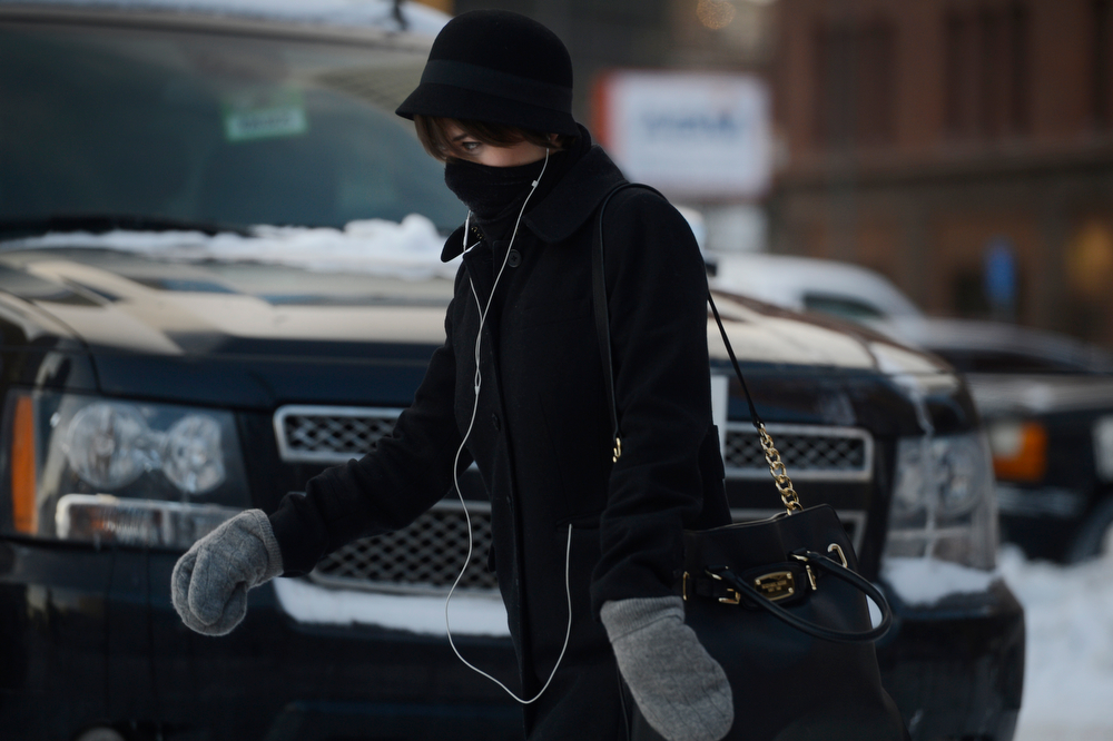 . A woman heads up 18th Ave near Broadway in below zero temperatures Wednesday morning, February 05, 2014. (Photo By Andy Cross / The Denver Post)