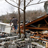 Residents search through debris after a suspected tornado ripped through early morning destroying several homes and businesses on Wednesday, Jan. 30, 2013, in Coble, Tenn. A massive storm system is raking the Southeast (AP Photo/Butch Dill)