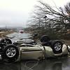 A vehicle lies on a road after a tornado moved through Adairsville, Ga. on Wednesday, Jan. 30, 2013. (AP Photo/David Goldman)