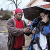 Darrell Lockridge consoles his wife Samantha in Bordeaux section of Nashville, Tenn., Wednesday Jan. 30, 2013.  Her uncle, Vernon Hartsell was killed when a large tree fell on the shed where he was taking shelter.  (AP Photo/The Tennessean, John Partipilo)