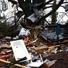 Debris lies on yard after a tornado moved through  Adairsville, Ga. Wednesday, Jan. 30, 2013. (AP Photo/David Goldman)
