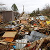 Several houses and businesses were destroyed after a storm ripped through Coble, Tenn. early Wednesday, Jan. 30, 2013. A large storm system packing high winds, hail and at least one tornado tore across a wide swath of the South and Midwest on Wednesday, killing one person, blacking out power to thousands and damaging homes. (AP Photo/Butch Dill)