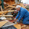 Ronnie Shanes searches through debris of his brother's home after a storm ripped through Coble, Tenn. early Wednesday, Jan. 30, 2013. A large storm system packing high winds, hail and at least one tornado tore across a wide swath of the South and Midwest on Wednesday, killing one person, blacking out power to thousands and damiging homes. (AP Photo/Butch Dill)