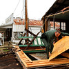 Hickman County Sheriff, Cody Woods helps remove debris from a house after a storm ripped through early morning on Wednesday, Jan. 30, 2013, in Coble, Tenn.   A line of strong storms is pushing eastward across Tennessee, triggering tornado warnings and producing strong downpours of rain. (AP Photo/Butch Dill)
