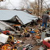 Residents search through debris after a storm ripped through Coble, Tenn. early Wednesday, Jan. 30, 2013. (AP Photo/Butch Dill)