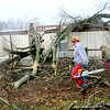 Workers remove portions of a tree that went through a trailer on West Walker Avenue on Wednesday, Jan. 30, 2013, in Galatia, Ill. A severe storm ripped through a small part of the Saline County town late Tuesday evening. (AP Photo/The Southern Illinoisan, Paul Newton)