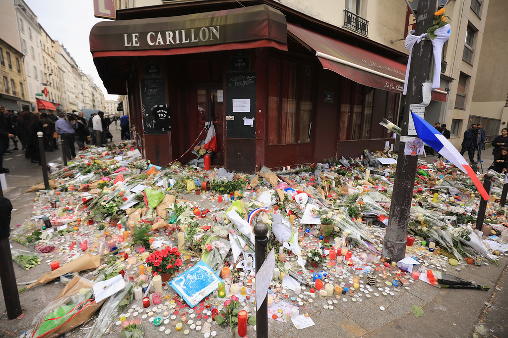 . A general view of the tributes outside the Le Carillon restaurant, one of the scenes of last friday\'s terror attacks, on November 16, 2015 in Paris, France. Countries across Europe joined France, currently observing three days of national mourning, in a one minute-silence today in an expression of solidarity with the victims of the terrorist attacks, which left at least 129 people dead and hundreds more injured.  (Photo by Christopher Furlong/Getty Images)