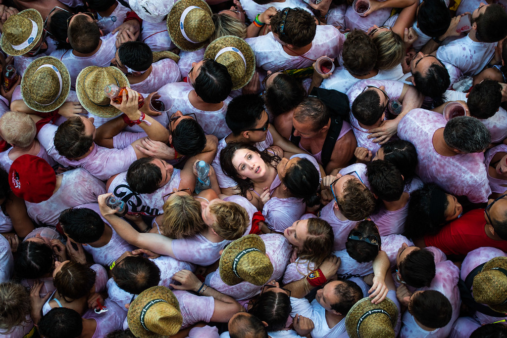 . Revellers enjoy the atmosphere during the opening day or \'Chupinazo\' of the San Fermin Running of the Bulls fiesta on July 6, 2015 in Pamplona, Spain. The annual Fiesta de San Fermin, made famous by the 1926 novel of US writer Ernest Hemmingway entitled \'The Sun Also Rises\', involves the daily running of the bulls through the historic heart of Pamplona to the bull ring.  (Photo by David Ramos/Getty Images)