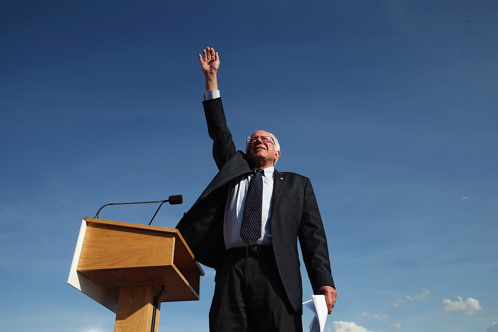 . Democratic presidential candidate U.S. Sen. Bernie Sanders (I-VT) waves to supporters before he speaks during the kick off of his presidential campaign on May 26, 2015 in Burlington, Vermont. Sanders will run as a Democrat in the presidential election and is former Secretary of State Hillary Clinton\'s first challenger for the Democratic nomination.  (Photo by Win McNamee/Getty Images)