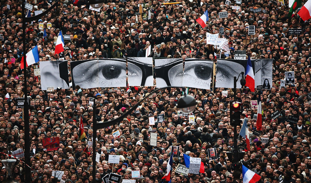 . Demonstrators make their way along Boulevard Voltaire in a unity rally in Paris following the recent terrorist attacks on January 11, 2015 in Paris, France. An estimated one million people are expected to converge in central Paris for the Unity March joining in solidarity with the 17 victims of this week\'s terrorist attacks in the country. French President Francois Hollande will lead the march and will be joined by world leaders in a sign of unity. The terrorist atrocities started on Wednesday with the attack on the French satirical magazine Charlie Hebdo, killing 12, and ended on Friday with sieges at a printing company in Dammartin en Goele and a Kosher supermarket in Paris with four hostages and three suspects being killed. A fourth suspect, Hayat Boumeddiene, 26, escaped and is wanted in connection with the murder of a policewoman.  (Photo by Christopher Furlong/Getty Images)