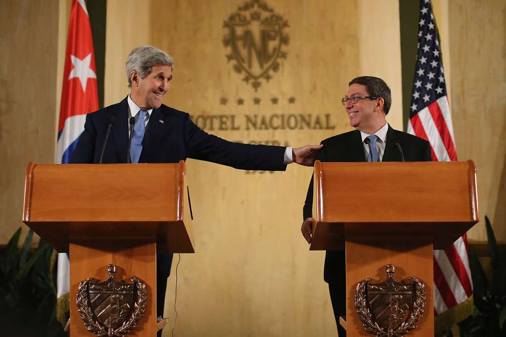 . U.S. Secretary of State John Kerry (L) and Cuban Minister of Foreign Affairs Bruno Rodriguez Parrilla hold a joint news conference at the Hotel Nacional August 14, 2015 in Havana, Cuba. The first American secretary of state to visit Cuba since 1945, Kerry presided over the flag-raising ceremony at the recently reopened U.S. Embassy, a symbolic act after the the two Cold War enemies reestablished diplomatic relations in July.  (Photo by Chip Somodevilla/Getty Images)