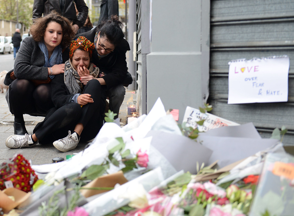. A woman cries near Le Petit Cambodge restaurant, the day after a deadly attack on November 14, 2015 in Paris, France. At least 120 people have been killed and over 200 injured, 80 of which seriously, following a series of terrorist attacks in the French capital.  (Photo by Antoine Antoniol/Getty Images)