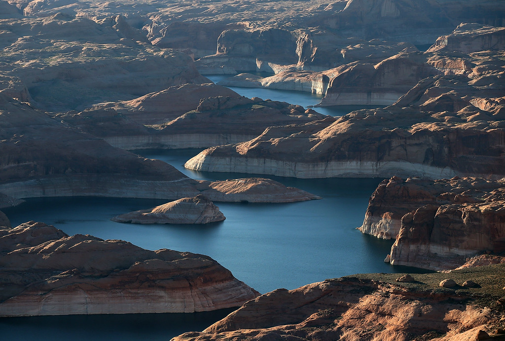 """. A bleached \""""bathtub ring\"""" is visible on the rocky banks of Lake Powell on March 28, 2015 in Lake Powell, Utah.  As severe drought grips parts of the Western United States, a below average flow of water is expected to enter Lake Powell and Lake Mead, the two biggest reservoirs of the Colorado River Basin. Lake Powell is currently at 45 percent of capacity, a recent study predicts water elevation there to be above 3,575 by September. The Colorado River Basin supplies water to 40 million people in seven western states. (Photo by Justin Sullivan/Getty Images)"""