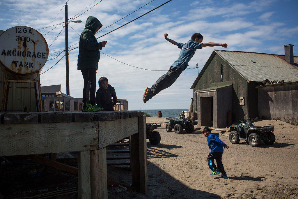 . Village children jump off of a loading dock on July 8, 2015 in Shishmaref, Alaska. Earlier this year the Obama administration approved Shell Oil to begin drilling for oil in Arctic regions, including the Chukchi sea, worrying locals who live in the region and disappointing conservationists.  (Photo by Andrew Burton/Getty Images)