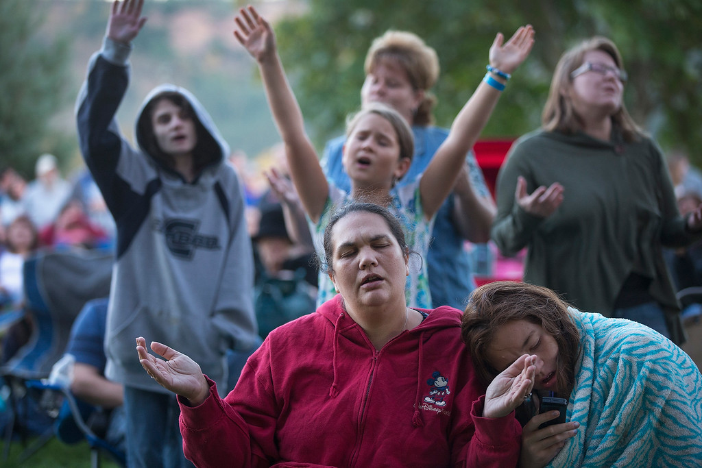 . Residents of Douglas County attend a prayer service and candlelight vigil at River Bend Park to remember the victims of the mass shooting at Umpqua Community College in nearby Roseburg on October 3, 2015 in Winston, Oregon.  On Thursday 26-year-old Chris Harper Mercer went on a shooting rampage at the college killing nine people and wounding another nine before killing himself. (Photo by Scott Olson/Getty Images)