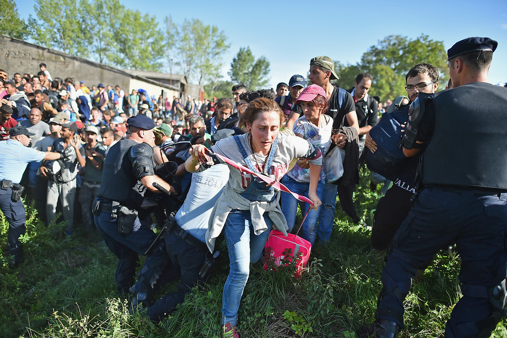 . Migrants force their way through police lines at Tovarnik station to board a train bound for Zagreb on September 17, 2015 in Tovarnik, Croatia. Migrants are now diverting to Croatia from Serbia after Hungary closed its border with Serbia, with the majority of them trying to reach Germany amid divisions within the European Union over how to manage the ongoing crisis. (Photo by Jeff J Mitchell/Getty Images)