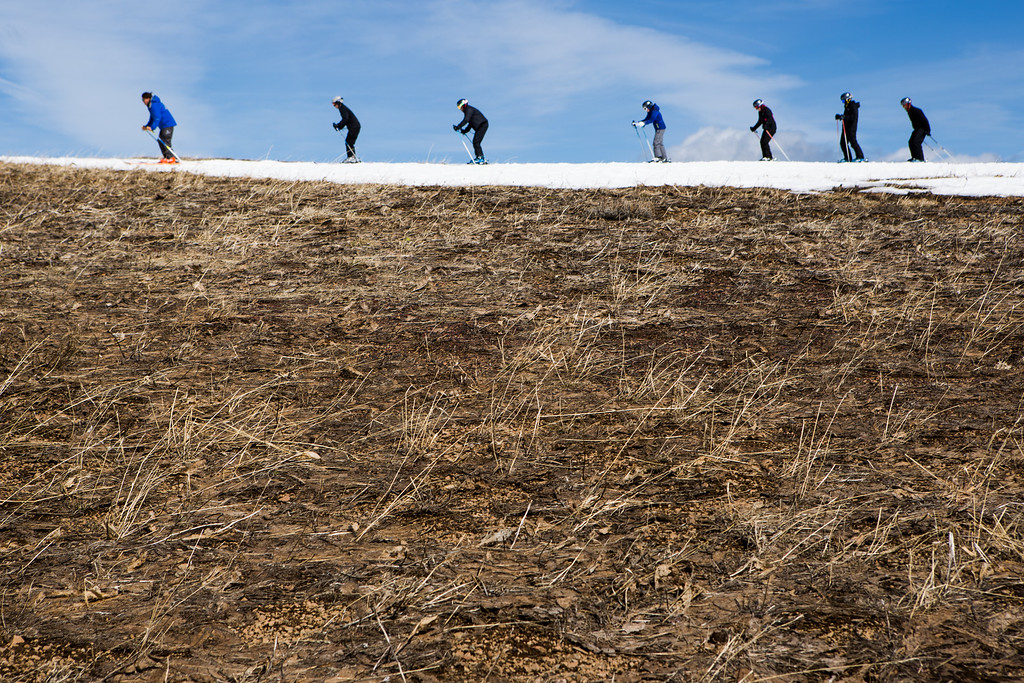 . Skiers thread their way through patches of dry ground at Squaw Valley Ski Resort, March 21, 2015 in Olympic Valley, California. Many Tahoe-area ski resorts have closed due to low snowfall as California\'s historic drought continues. (Photo by Max Whittaker/Getty Images)