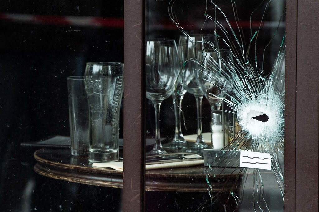. Bullet holes and marks are seen on the windows of the Cafe Bonne Biere restaurant on November 14, 2015 in Paris, France. At least 120 people have been killed and over 200 injured, 80 of which seriously, following a series of terrorist attacks in the French capital.  (Photo by David Ramos/Getty Images)