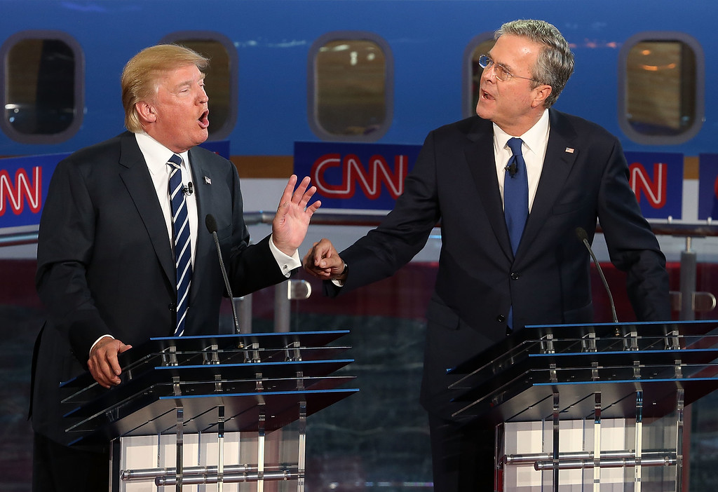 . Republican presidential candidates Donald Trump (L) and Jeb Bush argue during the presidential debates at the Reagan Library on September 16, 2015 in Simi Valley, California. Fifteen Republican presidential candidates are participating in the second set of Republican presidential debates.  (Photo by Justin Sullivan/Getty Images)
