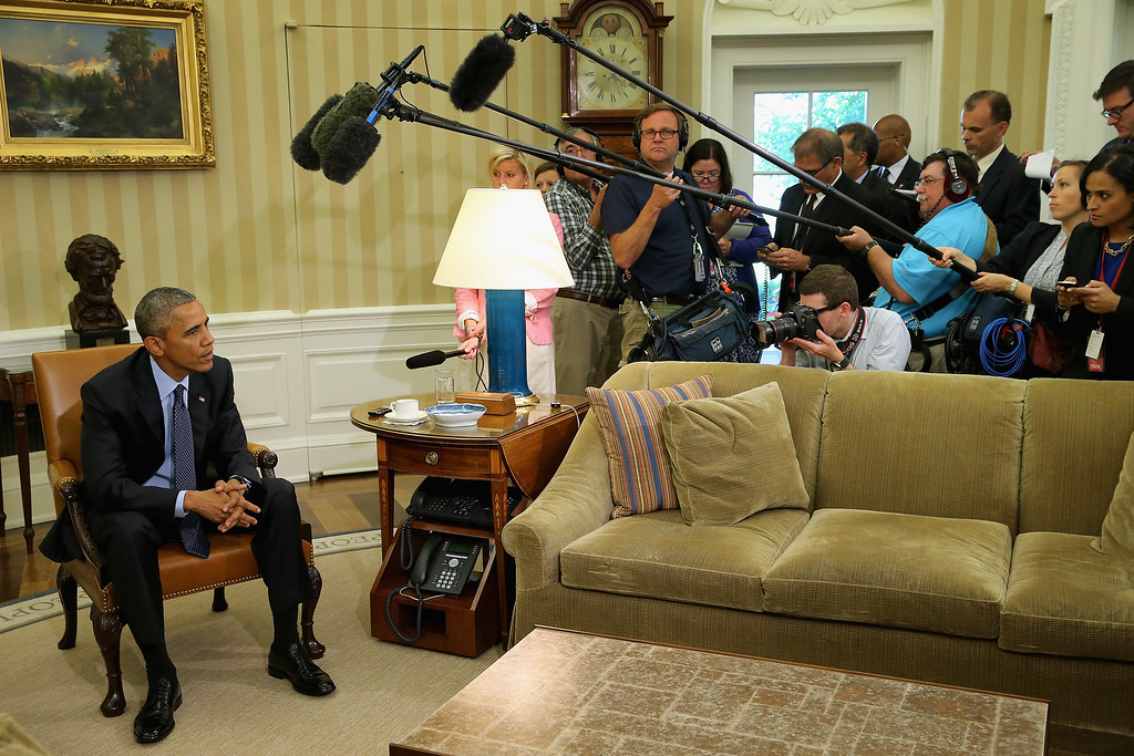 . U.S. President Barack Obama (L) talks to members of the news media in the Oval Office at the White House May 29, 2015 in Washington, DC. Calling it an essential piece of legislation for fighting terrorism, Obama demanded that the U.S. Senate pass the USA Freedom Act, a piece of legislation that would end bulk collection of Americans\' metadata, improve the FISA court and other security reforms.  (Photo by Chip Somodevilla/Getty Images)