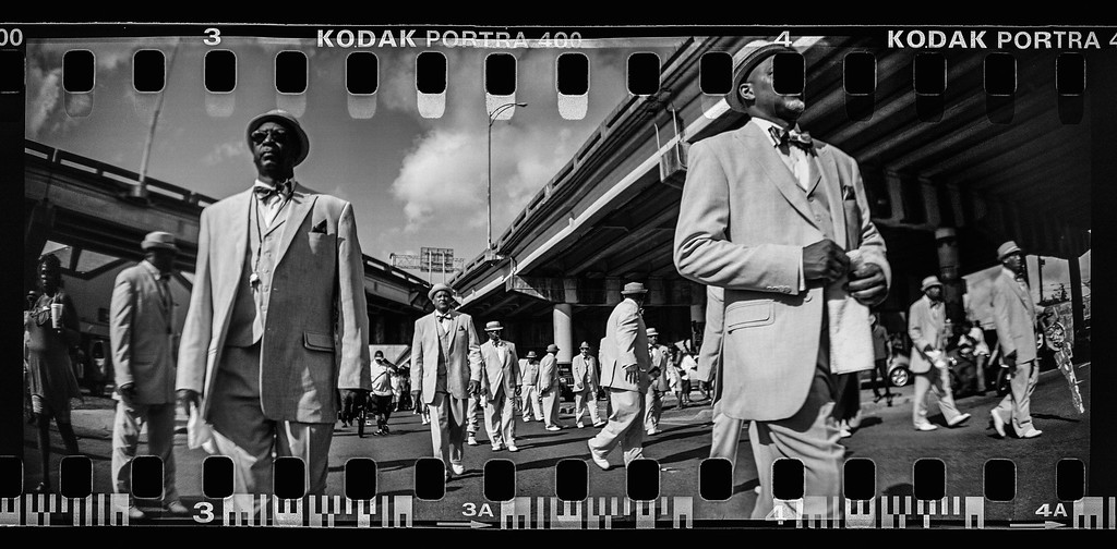 . (This Image was made with a panoramic film camera and scanned into a black and white digital file) Members of the Zulu Tramps gather during the Zulu Social Aid and Pleasure Club \'second line\' parade on May 17, 2015 in New Orleans, Louisiana. Traditional second line parades are put on by social aid and pleasure clubs organized by neighborhood in New Orleans. The parades represent a history of solidarity, empowerment and cultural pride within the African-American enclaves of the city. The tenth anniversary of Hurricane Katrina, which killed at least 1836 and is considered the costliest natural disaster in U.S. history, is August 29.  (Photo by Mario Tama/Getty Images)