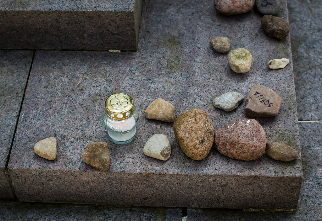 . Stones are placed at the foot of a granite Holocaust survivor memorial in the Paneriai memorial, in memory of the Jews of Vilnius killed by the Nazi during World War II, in Vilnius, Lithuania, Thursday, May 5, 2016.  Between July 1941 and August 1944, approximately 100,000 people of whom over half were Jewish were murdered at the site by the Nazis and a group of Lithuanians from organizations such as the Vilnius Special Squad. (AP Photo/Mindaugas Kulbis)