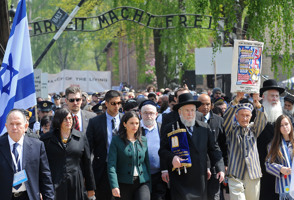 """. Rabbi Yisrael Meir Lau, fourth right, and Israeli Minister of Justice Ayelet Shaked, sixth right, walk through the gate with the inscription  \""""Arbeit Macht Frei\""""  in the Auschwitz-Birkenau German Nazi Death Camp at the start of the 25th March of the Living,  in Oswiecim, Poland, Thursday, May 5, 2016. (AP Photo/Alik Keplicz)"""