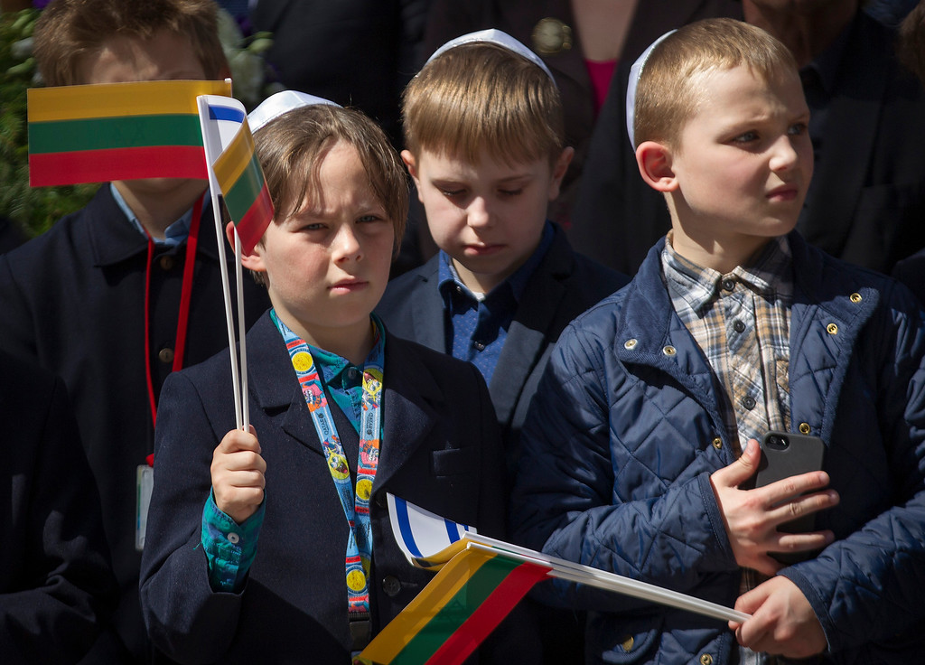 . Children take part in a symbolic \'March of Living\' at the Paneriai memorial in memory of the Jews of Vilnius killed by Nazi during World War II, in Vilnius, Lithuania, Thursday, May 5, 2016. Between July 1941 and August 1944, approximately 100,000 people of whom over half were Jewish were murdered at the site by the Nazis and a group of Lithuanians from organizations such as the Vilnius Special Squad. (AP Photo/Mindaugas Kulbis)