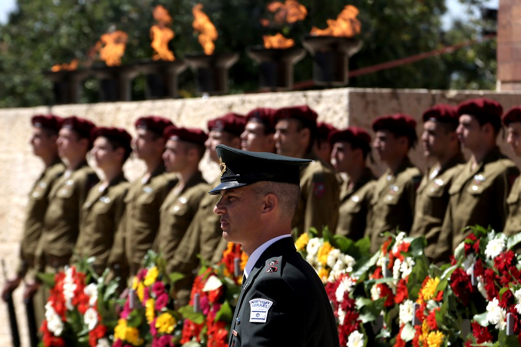 . An Israeli honor guard stands to attention during a ceremony marking the annual Holocaust Remembrance Day at the Yad Vashem Holocaust Memorial in Jerusalem on May 5, 2016. The state of Israel marks the annual Memorial Day commemorating the six million Jews murdered by the Nazis in the Holocaust during World War II. / AFP PHOTO / GALI TIBBON/AFP/Getty Images