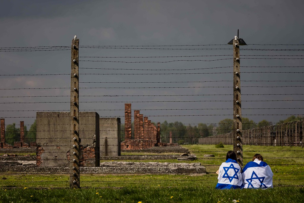 """. Participants of the annual \""""March of the Living\"""" are seen at the former Auschwitz-Birkenau Nazi death camp in Brzezinka (Birkenau) near Oswiecim (Auschwitz), Poland, on May 5, 2016. Thousands of young Jews from 40 nations marched alongside a handful of Holocaust survivors and Polish teenagers in homage to the victims of the former Auschwitz-Birkenau WWII death camp in southern Poland. / AFP PHOTO / WOJTEK RADWANSKI/AFP/Getty Images"""