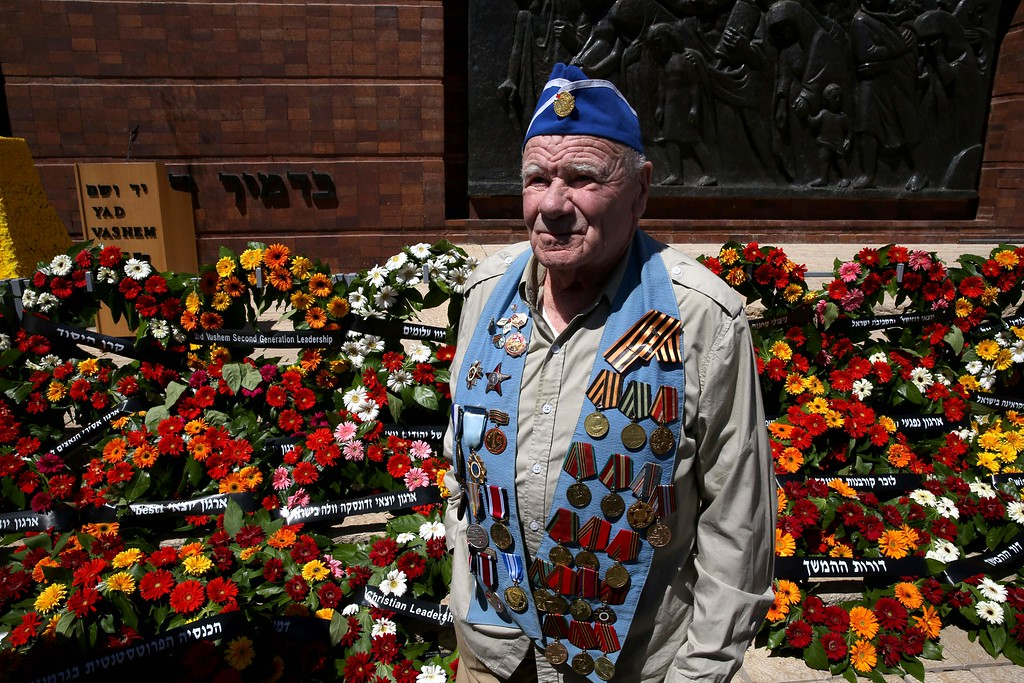 . A World War II veteran stands next to wreaths during the annual Holocaust Remembrance Day ceremony at the Yad Vashem Holocaust Memorial in Jerusalem on May 5, 2016. The state of Israel marks the annual Memorial Day commemorating the six million Jews murdered by the Nazis in the Holocaust during World War II. / AFP PHOTO / GALI TIBBON/AFP/Getty Images