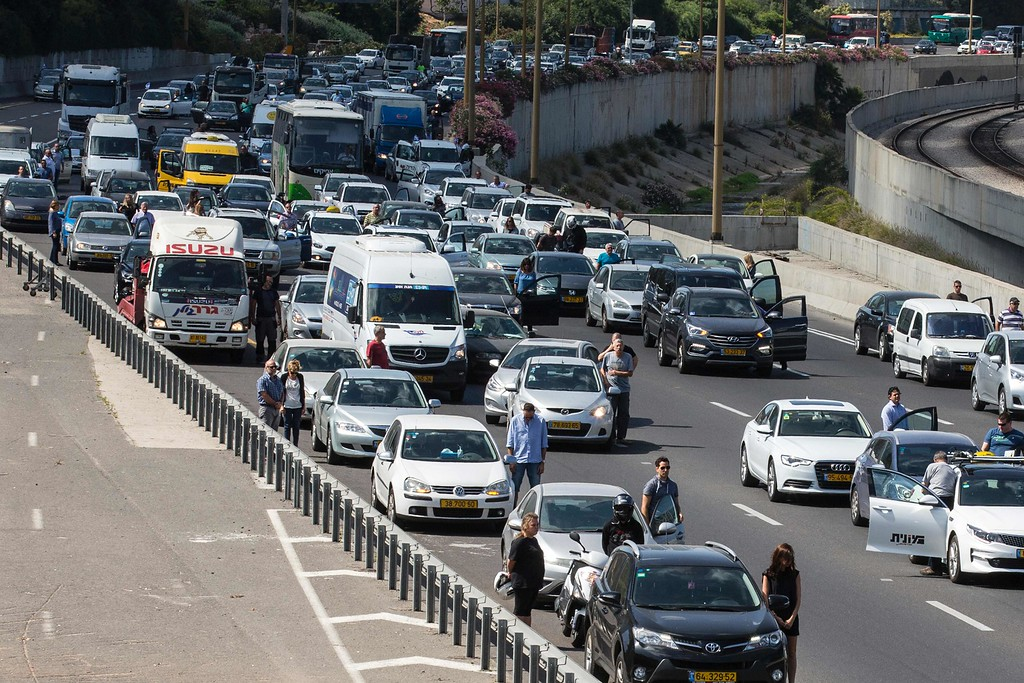 . People stop and stand in silence on a highway in the Israeli city of Tel Aviv on May 5, 2016, as sirens wailed across Israel for two minutes marking the annual day of remembrance for the six million Jewish victims of the Nazi genocide. Israel began marking Holocaust Martyrs and Heroes Remembrance Day at sundown on May 4 with a ceremony at the Yad Vashem memorial museum in Jerusalem, which commemorates the Jews killed by the Nazi regime during World War II.  / AFP PHOTO / JACK GUEZ/AFP/Getty Images