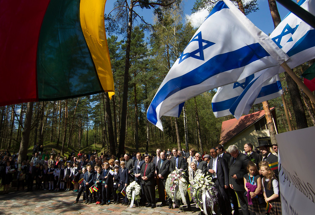 . People gather at the Paneriai memorial in memory of the Jews of Vilnius killed by Nazis during World War II, in Vilnius, Lithuania, Thursday, May 5, 2016.  Between July 1941 and August 1944, approximately 100,000 people of whom over half were Jewish were murdered at the site by the Nazis and a group of Lithuanians from organizations such as the Vilnius Special Squad. (AP Photo/Mindaugas Kulbis)