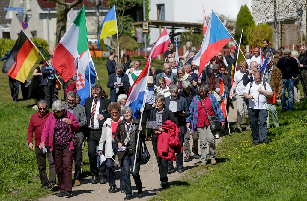 """. Citizens of Kiel and relatives of former concentration camp prisoners who took part in a death march from Hamburg to Kiel at the end of World War II walk over the grounds of the former \""""Arbeitserziehungslager Nordmark\"""" labour camp to commemorate the camp\'s victims on May 5, 2016 in Kiel, northern Germany. The event took place in line with the \""""March of the Living\"""", an annual educational program including a march from the Nazi concentration camp Auschwitz to Birkenau in remembrance of the victims of the Holocaust. / AFP PHOTO / dpa / Axel Heimken /AFP/Getty Images"""