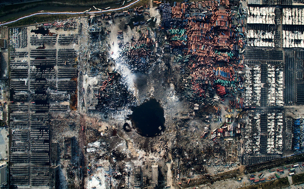 ". In this image released by World Press Photo titled ""Tianjin Explosion\"" by photographer Chen Jie which won third prize in the General News singles category shows an aerial view of the destruction after the explosion in Tianjin, China, Aug. 15, 2015.(Chen Jie, World Press Photo via AP)"