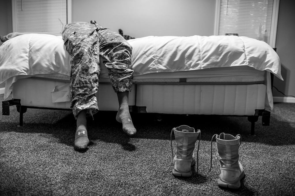 ". In this image released by World Press Photo titled ""Sexual Assault in America\'s Military\"" by photographer Mary F. Calvert which won first prize in the Long term Projects category shows US Army Spc. Natasha Schuette, 21, who was pressured not to report being assaulted by her drill sergeant during basic training at Fort Jackson, South Carolina. Though she was hazed by her assailant�s fellow drill instructors, she refused to back down and Staff Sgt. Louis Corral is now serving four years in prison for assaulting her and four other female trainees. The US Army rewarded Natasha for her courage to report her assault and the Sexual Harassment/ Assault Response & Prevention office distributed a training video featuring her story.  She is now stationed at Fort Bragg, North Carolina. (Mary F. Calvert, World Press Photo via AP)"