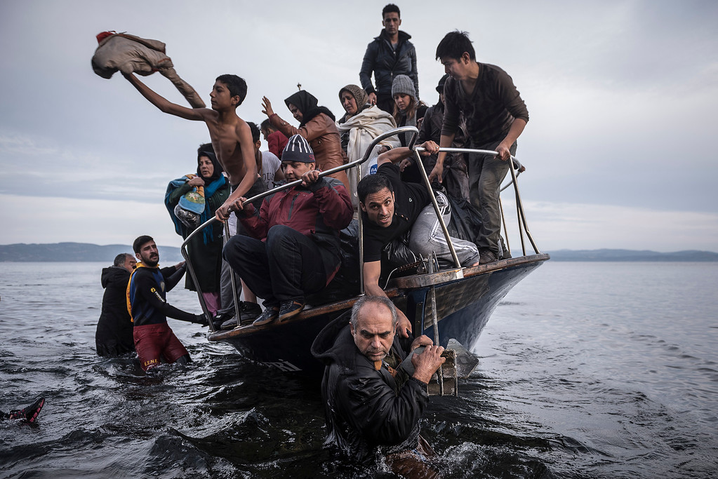 ". In this image released by World Press Photo titled ""Reporting Europe\'s Refugee Crisis\"" by photographer Sergey Ponomarev for The New York Times which won the first prize in the General News Stories category shows refugees arriving by boat near the village of Skala on Lesbos, Greece, 16 November 2015. (Sergey Ponomarev for The New York Times, World Press Photo via AP)"