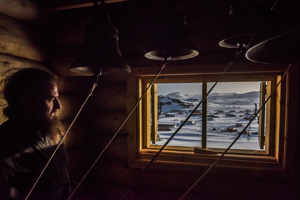 ". In this image released by World Press Photo titled ""An Antarctic Advantage\"" by photographer Daniel Berehulak for The New York Times which won first prize Daily Life stories shows a priest looking on in the Bell room, after a vigil at the Russian Orthodox Church of the Holy Trinity, Fildes Bay, Antartica, Dec. 3, 2015.(Daniel Berehulak/The New York Times, World Press Photo via AP)"