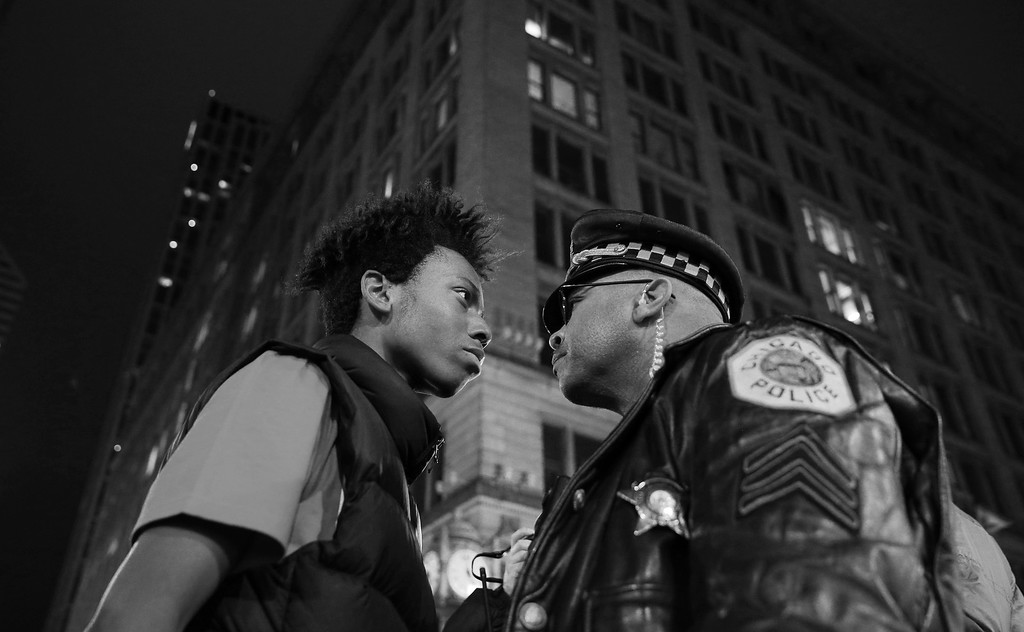 ". In this image released by World Press Photo titled ""March Against Police Violence\"" by photographer John J. Kim for the Chicago Tribune which won a third prize in the Contemporary Issues singles category shows Lamon Reccord staring down a police sergeant during a protest following the fatal shooting of Laquan McDonald by police in Chicago, Illinois, USA, Nov. 25, 2015.(John J. Kim/Chicago Tribune, World Press Photo via AP)"