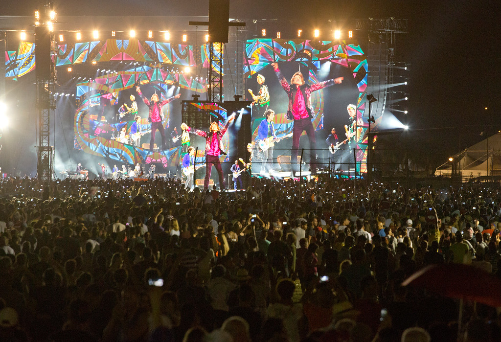 . The Rolling Stones are seen on giant screens as they perform for thousands at the Cuidad Deportiva in Havana, Cuba, Friday March 25, 2016. The Stones performed a free concert in Havana, becoming the most famous act to play Cuba since its 1959 revolution. (AP Photo/Desmond Boylan)