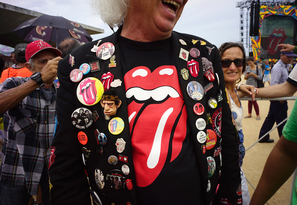 . A fan wearing Stones pins stands at the venue where the Rolling Stones will play their concert in Havana, Cuba, Friday, March 25, 2016. The Stones are performing in a free concert in Havana, becoming the most famous act to play Cuba since its 1959 revolution. (AP Photo/Ramon Espinosa)