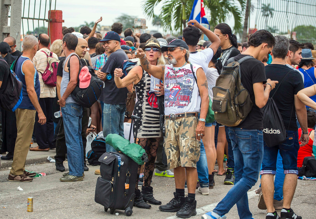. Carol Boprie, 55, from Detroit, Michigan, and John Sanchez, a Vietnam veteran from Daytona talk as they wait to enter Rolling Stones concert in Havana, Cuba, Friday, March 25, 2016.  The Stones are performing in a free concert in Havana Friday, becoming the most famous act to play Cuba since its 1959 revolution.(AP Photo/Desmond Boylan)