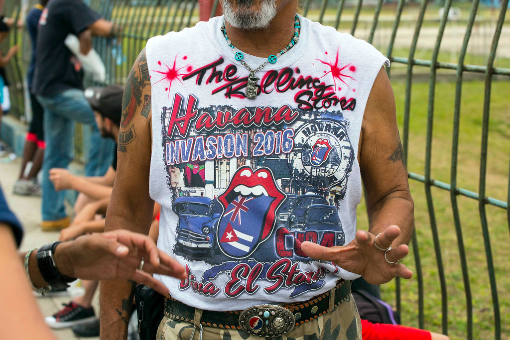 . Wearing a T-shirt designed for the occasion, Vietnam veteran from Daytona John Sanchez waits to enter Rolling Stones concert in Havana, Cuba, Friday, March 25, 2016. The Stones are performing in a free concert in Havana Friday, becoming the most famous act to play Cuba since its 1959 revolution.(AP Photo/Desmond Boylan)