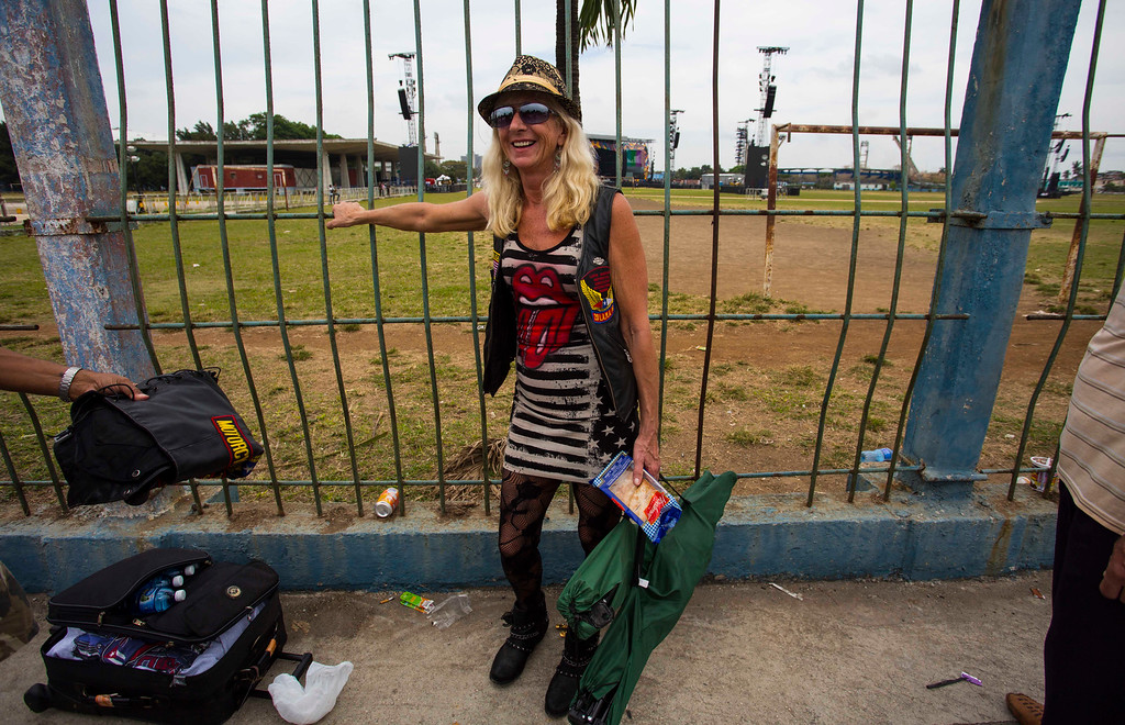 . Carol Boprie, 55, from Detroit, Michigan, waits to enter the venue where the Rolling Stones will play their concert in Havana, Cuba, Friday, March 25, 2016. The Stones are performing in a free concert in Havana Friday, becoming the most famous act to play Cuba since its 1959 revolution.(AP Photo/Desmond Boylan)