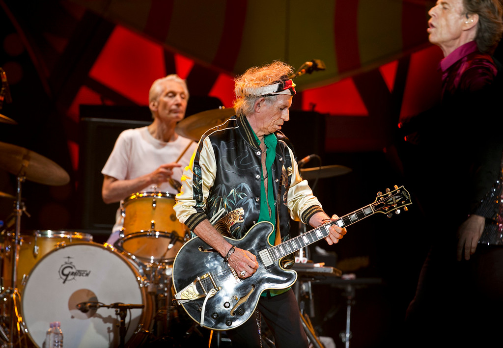 . Keith Richards plays his guitar as the Rolling Stones perform in Havana, Cuba, Friday March 25, 2016. At left Charlie Watts and at right Mick Jagger. The Stones are performing in a free concert in Havana Friday, becoming the most famous act to play Cuba since its 1959 revolution. (AP Photo/Enric Marti)