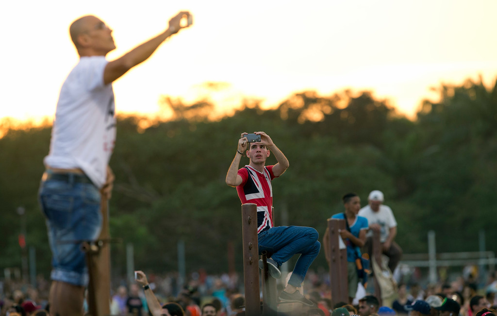 . Fans take pictures with their cells before the Rolling Stones concert at the Ciudad Deportiva in Havana, Cuba, Friday March 25, 2016. The Stones are performing in a free concert in Havana Friday, becoming the most famous act to play Cuba since its 1959 revolution. (AP Photo/Ramon Espinosa)