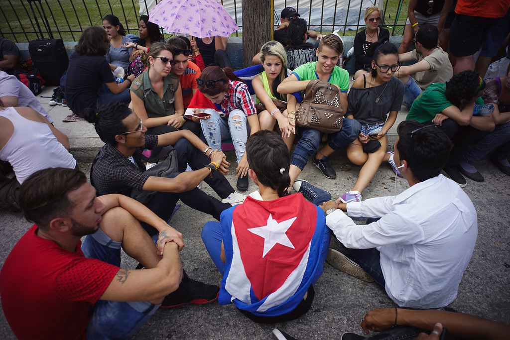 . Fans wait outside the venue where the Rolling Stones will play their concert in Havana, Cuba, Friday, March 25, 2016. The Stones are performing in a free concert in Havana Friday, becoming the most famous act to play Cuba since its 1959 revolution.(AP Photo/Ramon Espinosa)